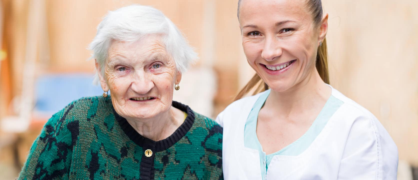 staff and elder woman smiling
