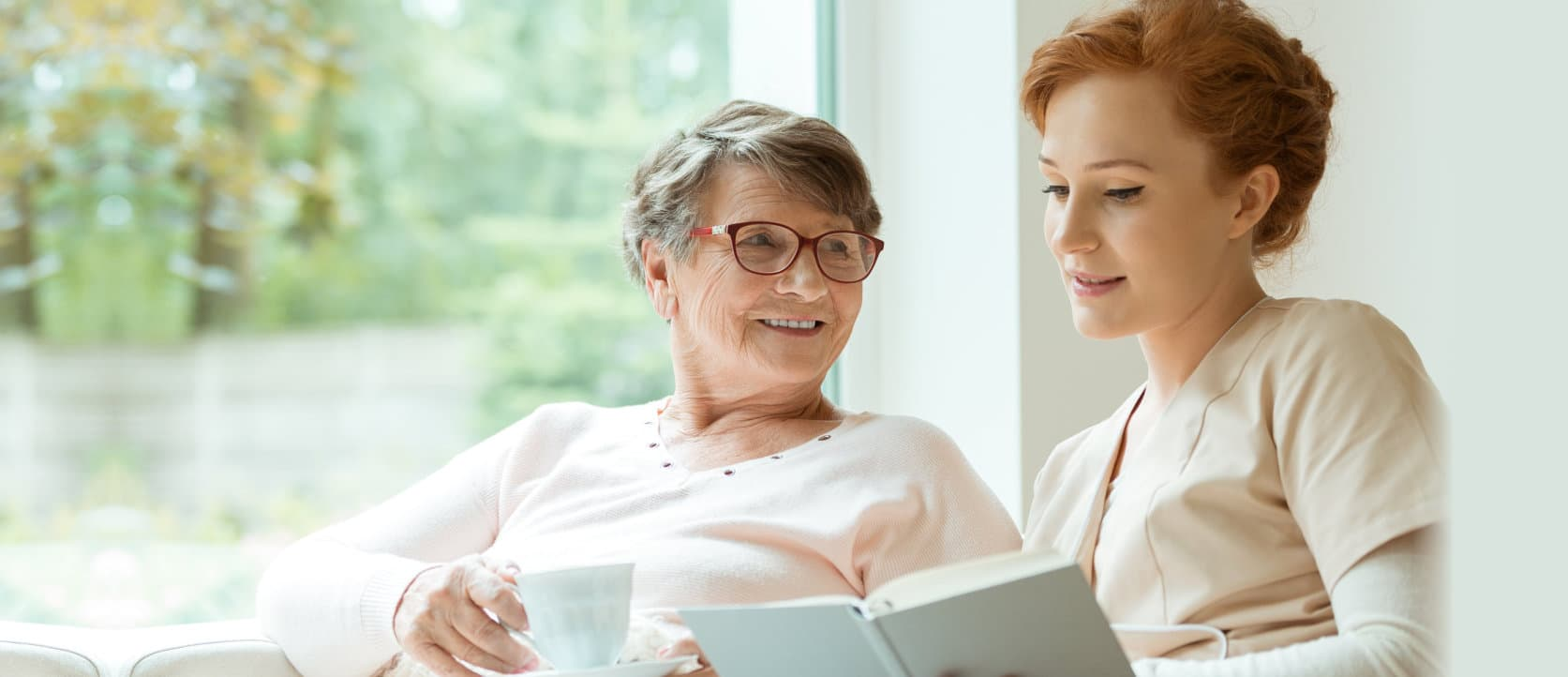 staff reading book for elder woman