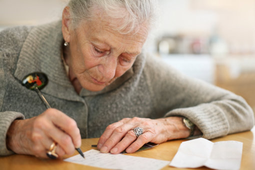 elder woman writing